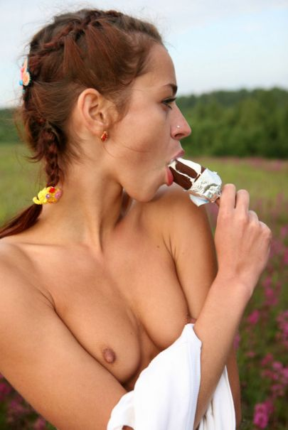 Young-sexy-girl-licking-ice-cream-outdoors-19